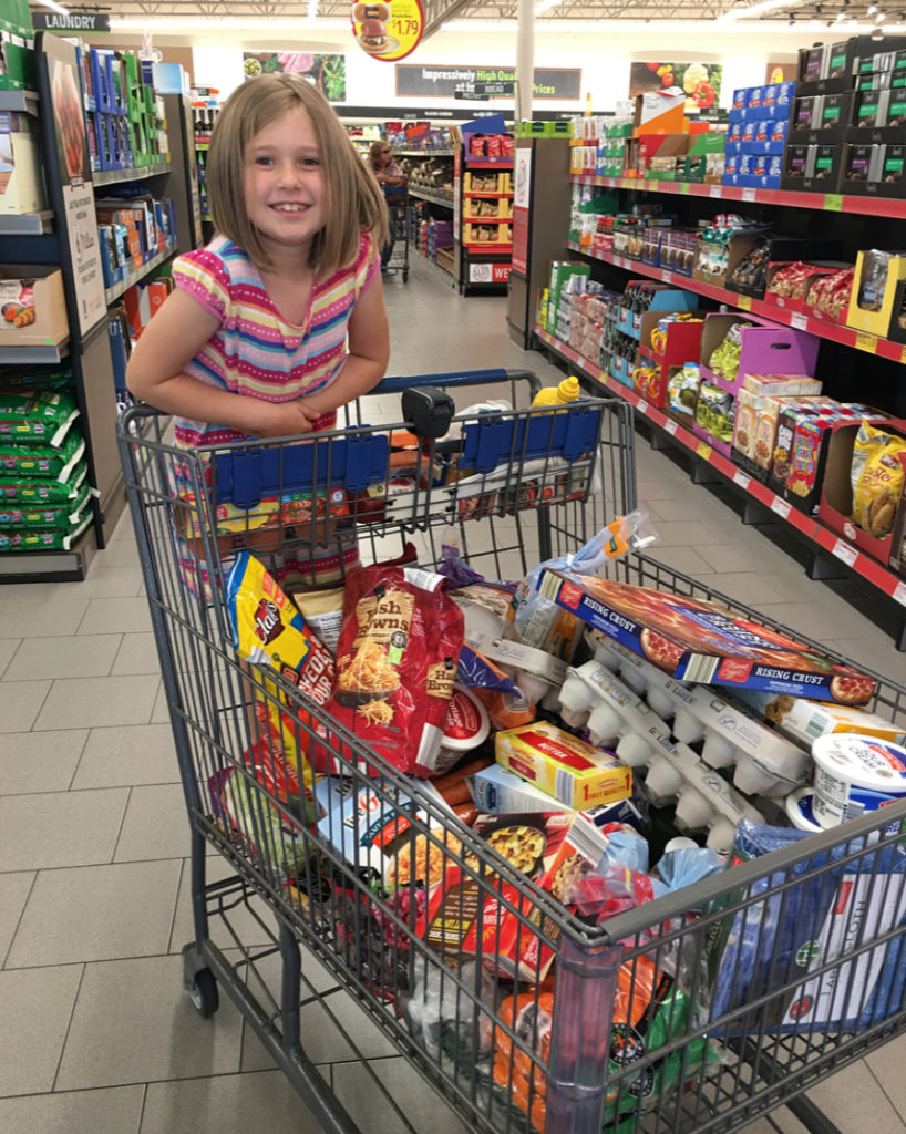 daughter helping with grocery shopping