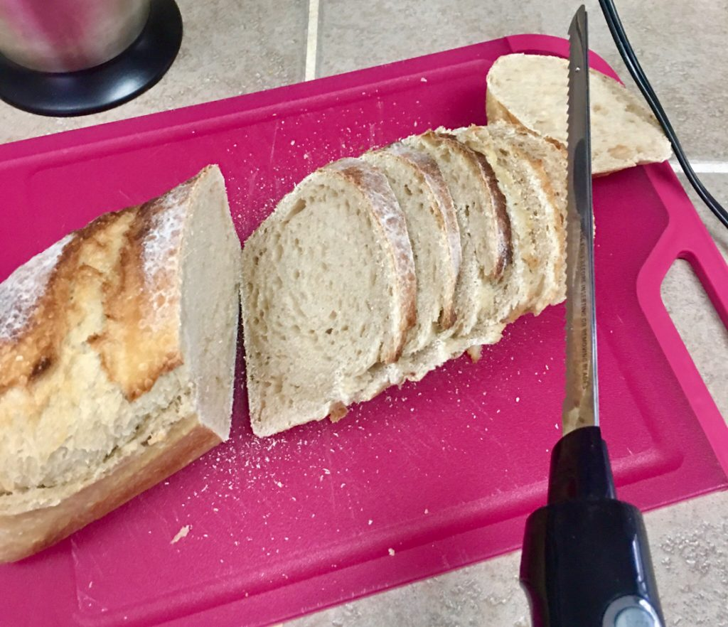 slicing sourdough bread with an electric knife