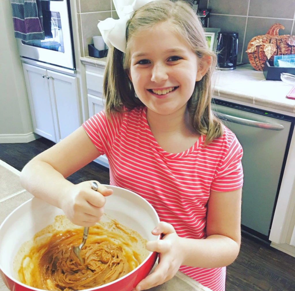 girl in kitchen baking