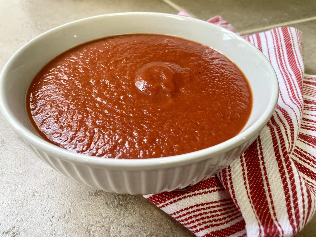 gray bowl filled with easy homemade pizza sauce