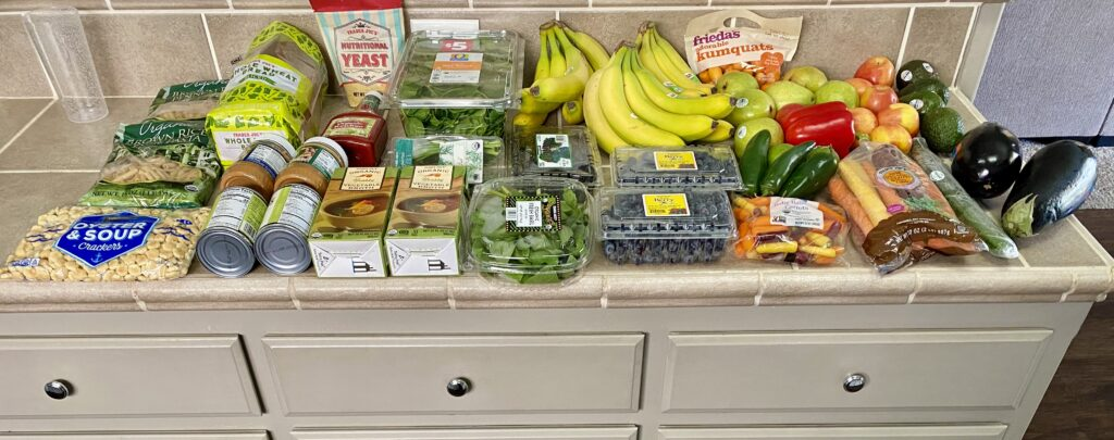counter filled with fresh food for the week