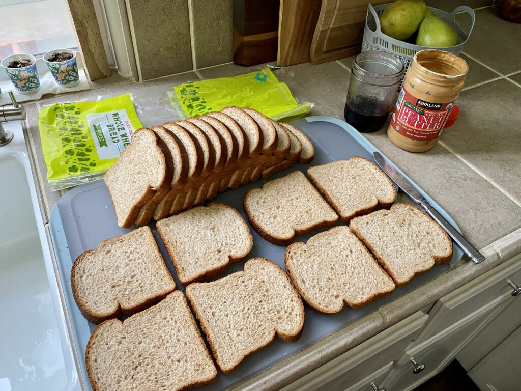 loaf of Trader Joe's sandwich bread making peanut butter and jelly sandwiches