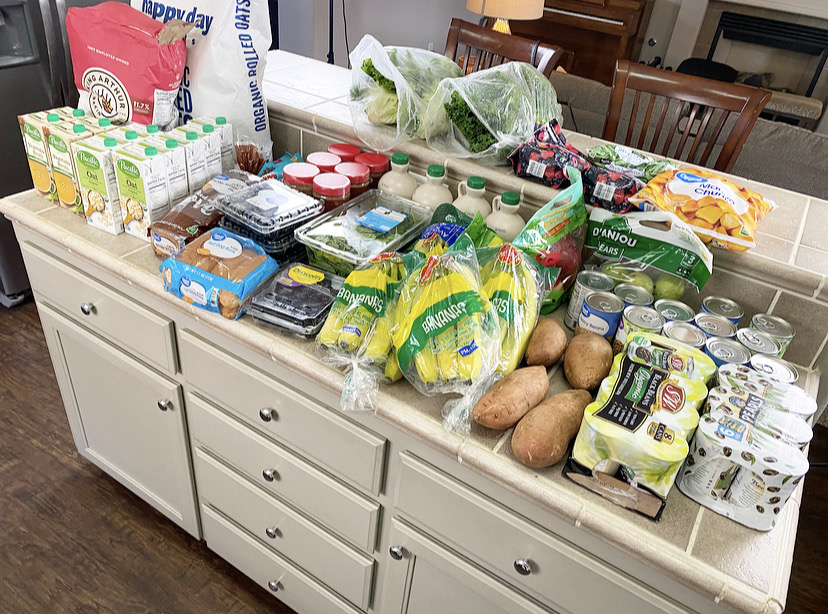 kitchen counter filled with produce and bulk buying foods