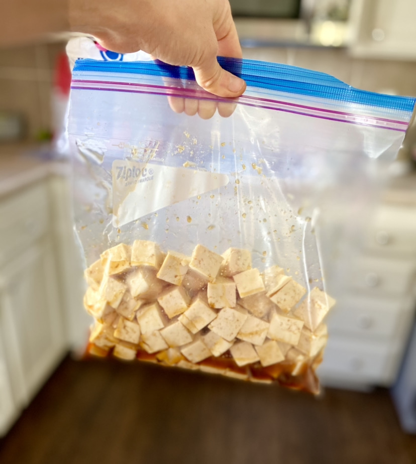 ziploc bag filled with marinated tofu