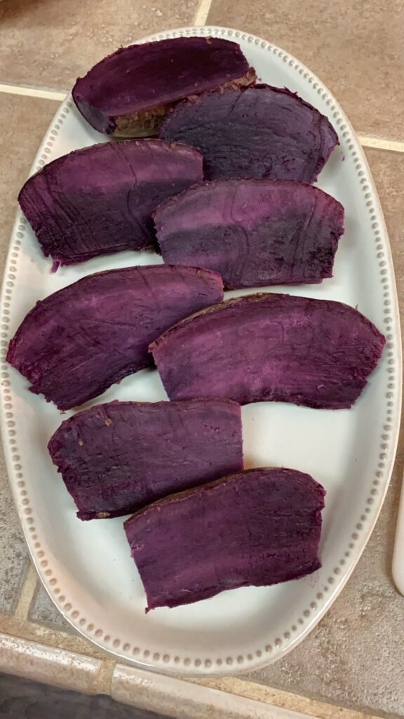 cream platter with sliced and cooked purple sweet potatoes